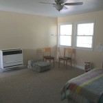 Living/studio bedroom area with gas wall heater