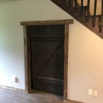 Under stairs storage with cool barn door feature